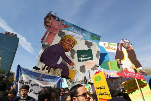On the eve of renewed sanctions by Washington, Iranian protesters carry placards that mock President Donald Trump, Saudi Arabia's King Salman and Crown Prince Mohammed bin Salman during a demonstration outside the former US embassy in the Iranian capital Tehran on November 4, 2018, marking the anniversary of its storming by student protesters that triggered a hostage crisis in 1979 [ATTA KENARE/AFP/Getty Images]