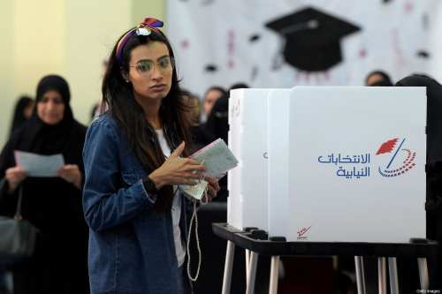 Bahraini voters cast their ballot for parliamentary election at a polling station in the Bahraini city of Al-Muharraq, north of Manama on November 24, 2018 [STR/AFP/Getty Images]