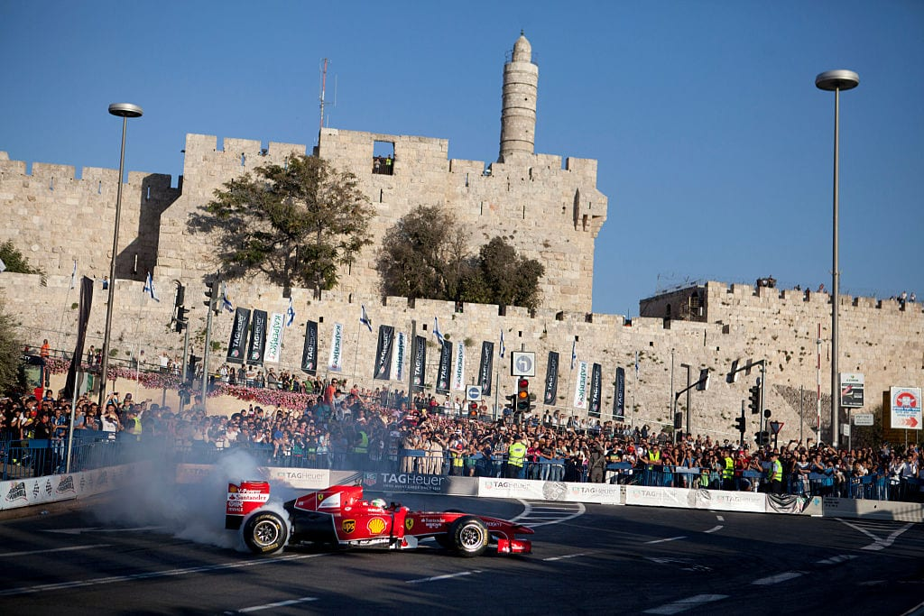 A Ferrari Formula One racing car in action during the 2014 edition of the Formula 1 Peace Road Show on October 6, 2014 in Jerusalem, Israel. (File photo by Lior Mizrahi/Getty Images)