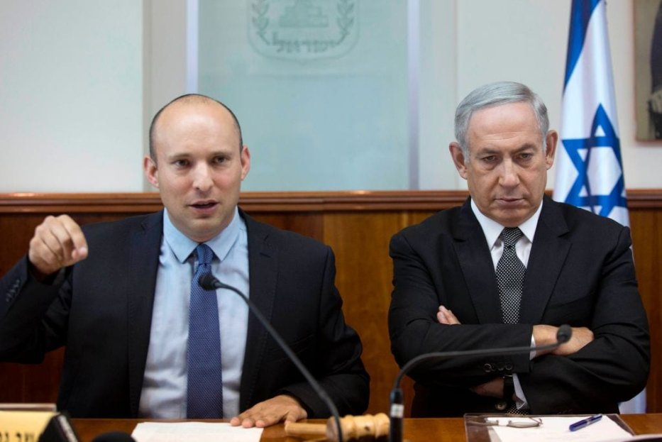 Israeli Prime Minister Benjamin Netanyahu (R) listens to former Education Minister, Naftali Bennett, during the weekly cabinet meeting on August 30, 2016 at his office in Jerusalem. [AFP/POOL/ABIR SULTAN/Getty Images]