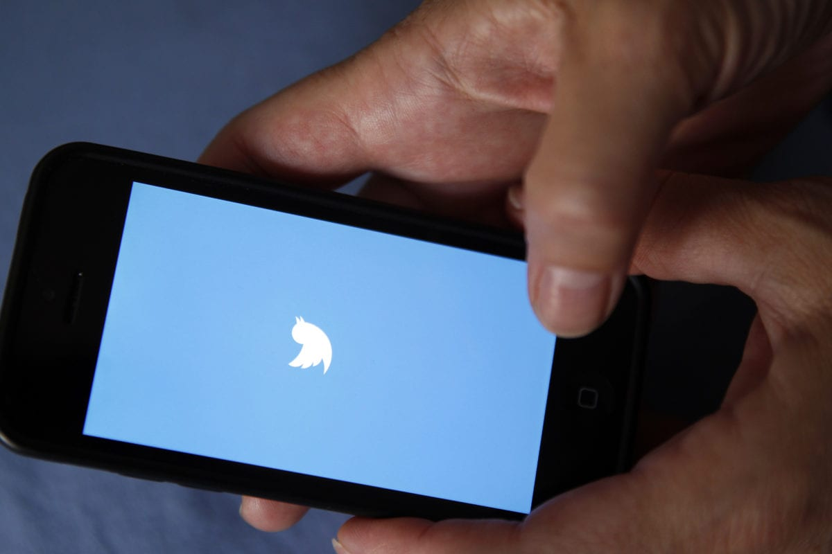 In this photo illustration, The Twitter logo is displayed on the screen of an Apple Inc. iPhone 5 in this arranged photograph on September 25, 2016 in Paris, France (Photo illustration by Chesnot/Getty Images)