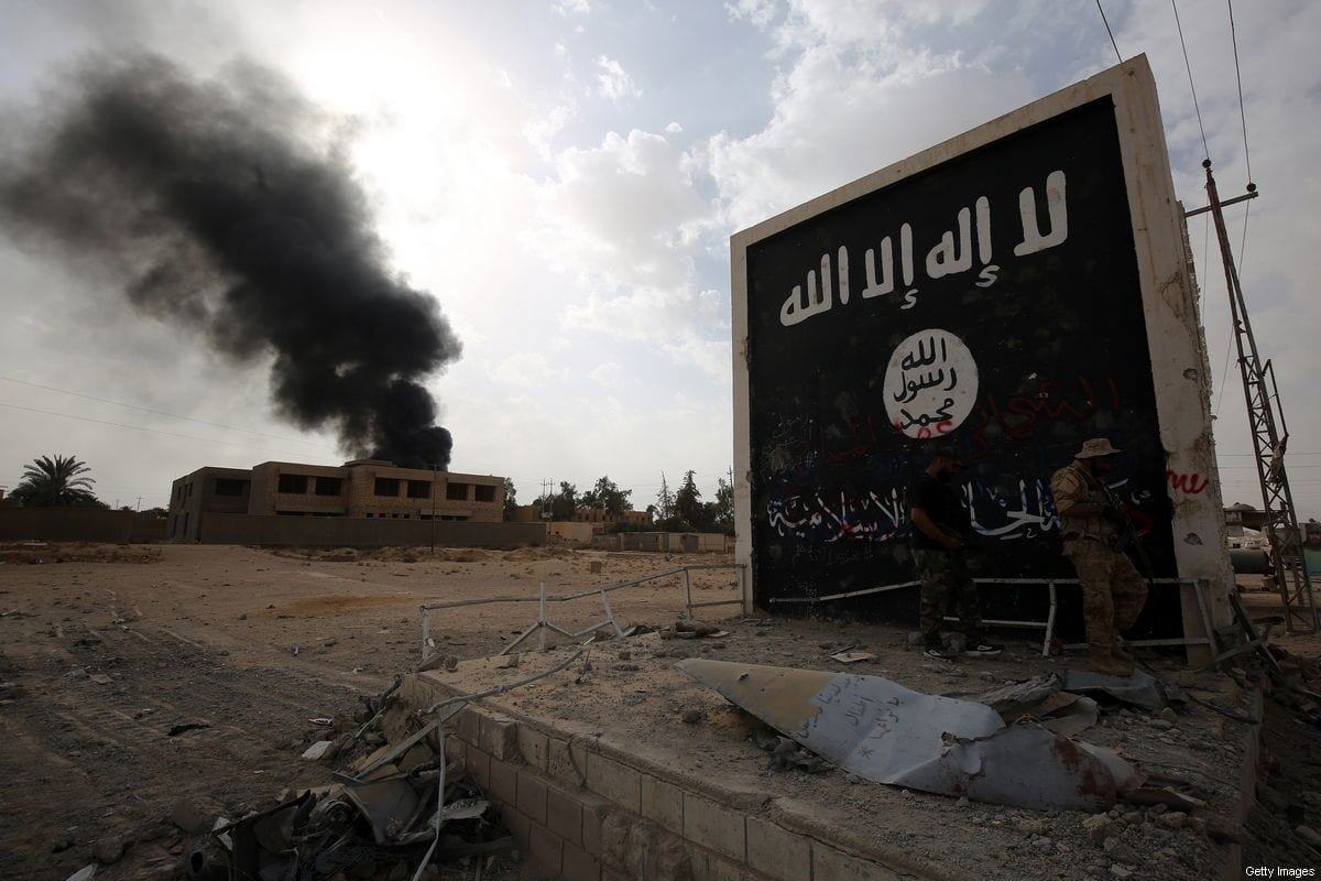 A Daesh sign at the entrance of the city of al-Qaim, in Iraq's western Anbar province near the Syrian border, seen on November 3, 2017 [AHMAD AL-RUBAYE/AFP/Getty Images]