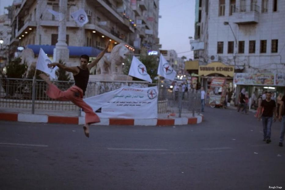 Maher dances in Al-Manara Square, Ramallah in the occupied West Bank