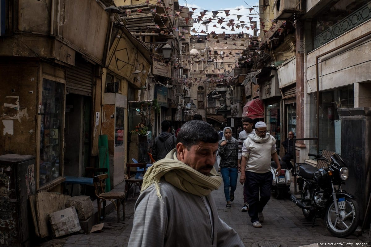 People are seen shopping in market street in Cairo, Egypt on 14 December 2016 [Chris McGrath/Getty Images]