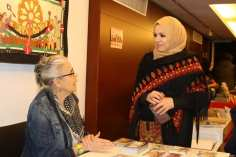 The registration desk at the Palestinian History Tapestry event in London on 11 December 2018 [Abdelrahman Said/Middle East Monitor]