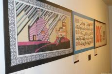 Two pieces of Palestinian tapestry work displayed at the P21 gallery in London on 11 December 2018 [Middle East Monitor]