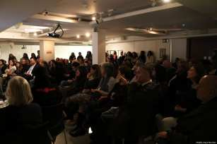Guests listen to the speakers at the Palestinian History Tapestry event in London on December 11 2018 [Middle East Monitor]
