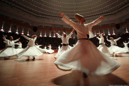 Dervishes perform during a ceremony marking the 745th death anniversary of Mevlana Jalaluddin al-Rumi in Turkey on on 12 December 2018 [Abdullah Coşkun/Anadolu Agency]