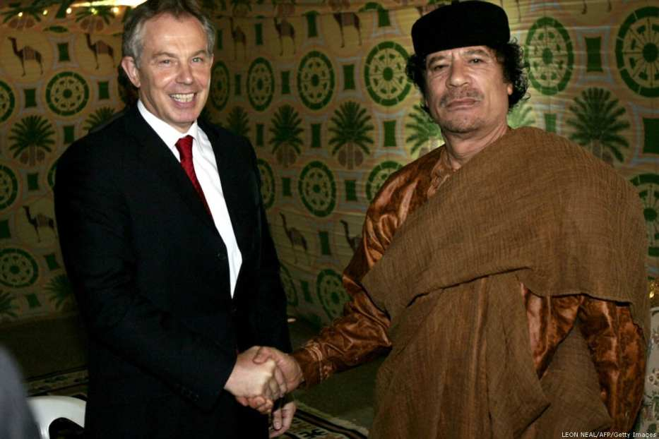 British Prime Minister Tony Blair (L) meets Libyan Leader Moamer Kadhafi to the central coastal of Sirte 29 May 2007. [Leon Neal/AFP/Getty Images]