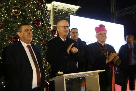 Palestinian Prime Minister, Rami Hamdallah attends the lighting of the Christmas tree on December 1, 2018 at the Manger Square near the Church of the Nativity, revered as the site of Jesus Christ's birth, in the biblical West Bank town of Bethlehem. [Prime Minister Office/Apaimages]