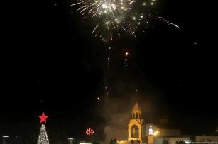 Fireworks light up the sky as streets and avenues near the Church of the Nativity in Bethlehem on 1 December 2018. [Issam Rimawi /Anadolu Agency]
