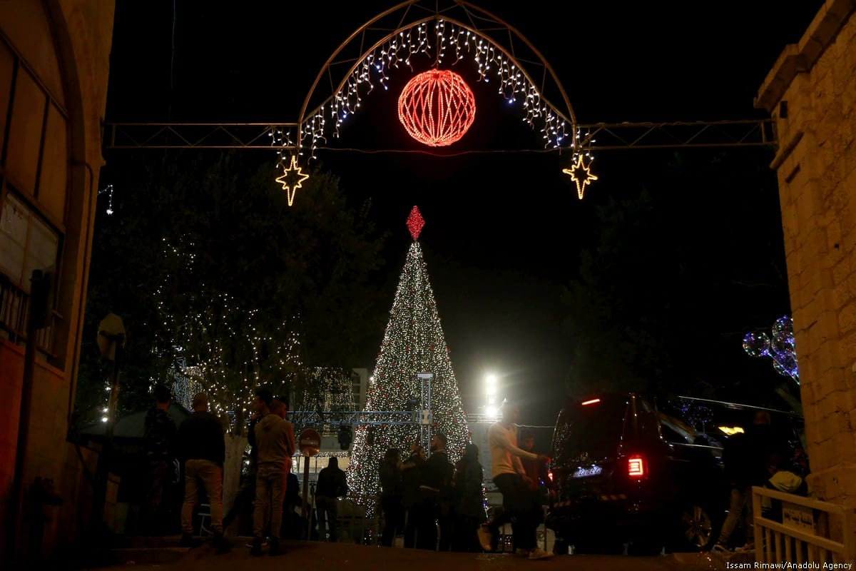 The illuminated Christmas Tree and sparkling lights are seen glittering over streets and avenues near the Church of the Nativity, in Bethlehem on 1 December 2018. [Issam Rimawi /Anadolu Agency]