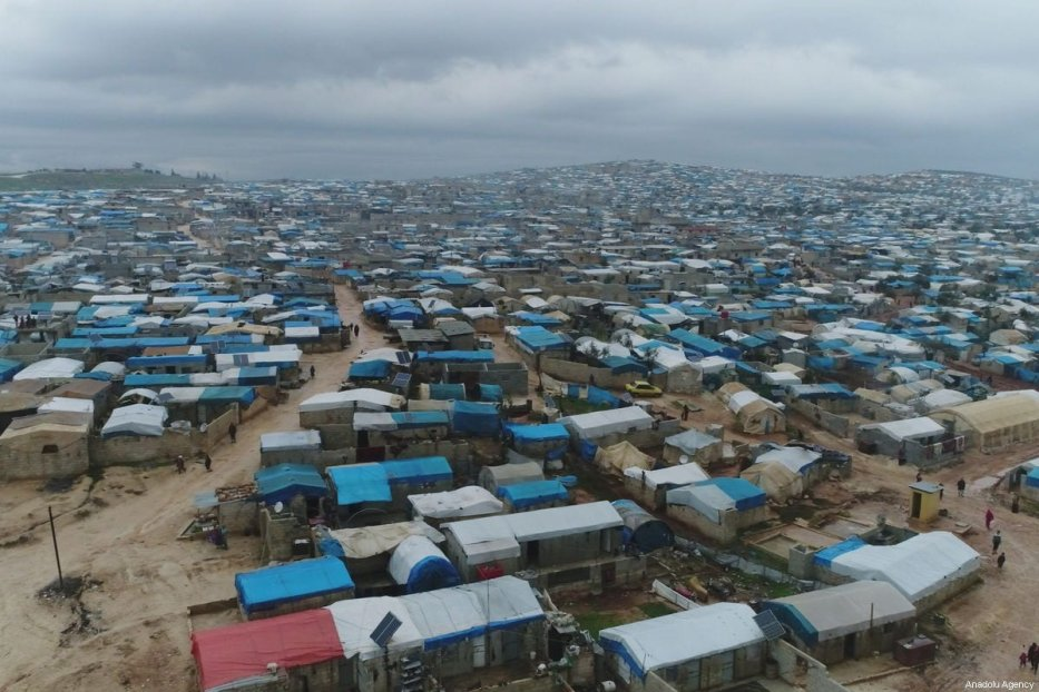 An aerial view of a refugee camp flooded after heavy rain on December 27, 2018 in Idlib, Syria. Tens of thousands of Syrian refugees residing in camps near the Turkish border are struggling to survive harsh winter conditions [Eşref Musa / Anadolu Agency]