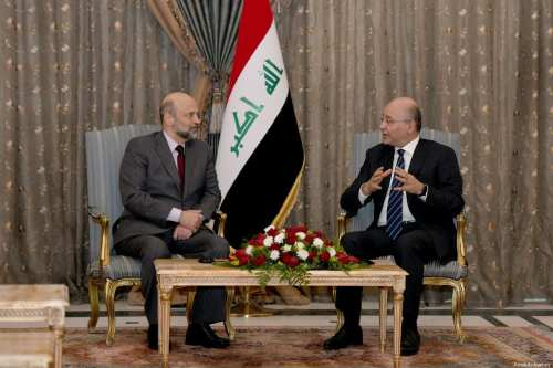 Iraqi President Barham Salih (R) and Jordanian Prime Minister Omar Razzaz (L) are seen during their meeting at presidential palace in Baghdad, Iraq on 29 December 2018 [Iraqi Presidency Press Office/Anadolu Agency]