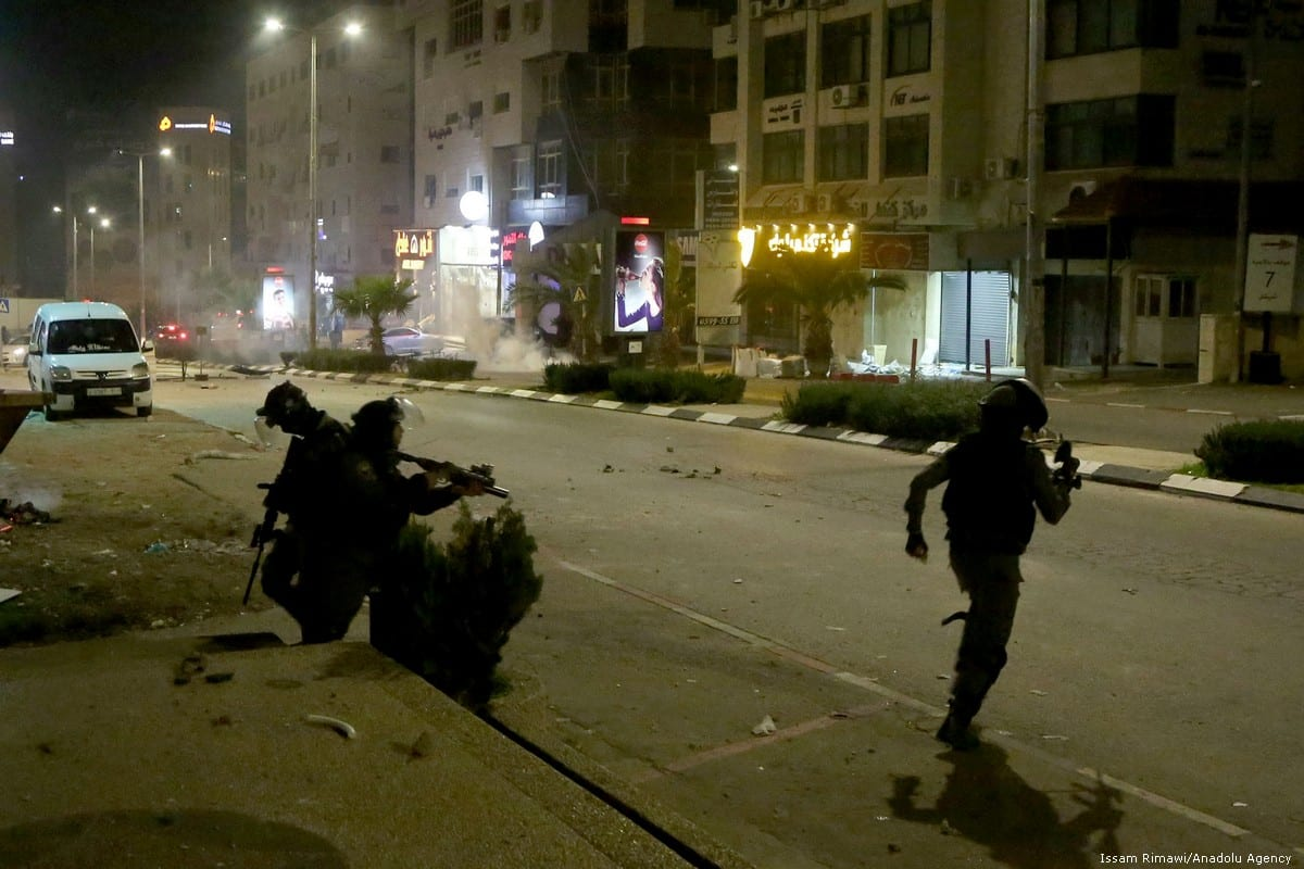 Israeli forces raid Palestinians houses and workplaces in Ramallah, West Bank on 11 December 2018 [Issam Rimawi/Anadolu Agency]