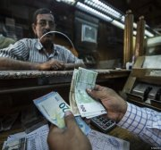 Egypt's banks told to limit withdrawals and deposits