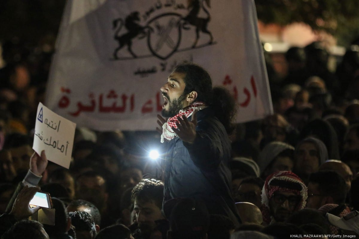 Jordanian protesters chant slogans during a demonstration against the government's decision to raise taxes in the capital Amman on November 30, 2018 [KHALIL MAZRAAWI/AFP/Getty Images]