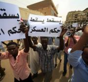 Sudanese policeman dies from wounds after protesters stone vehicle