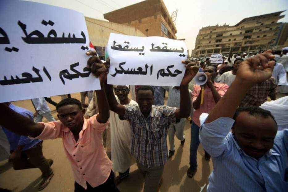 Hundreds of protesters come together during a demonstrations against the soaring prices and the scarcity of basic goods and services in Sudan on 20 December 2018