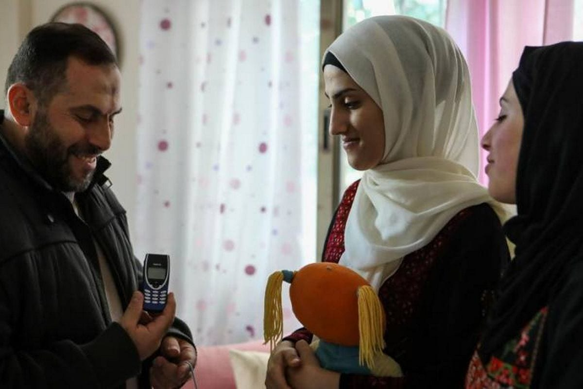 After 18 years, Imad Al-Din Al-Saftawi has finally been able to give his wife a mobile phone, the present he bought for her before he was in prison