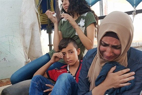 Suzan Abu Ghannam grieves hours after her son's killing on July 21. [Maan News Agency]