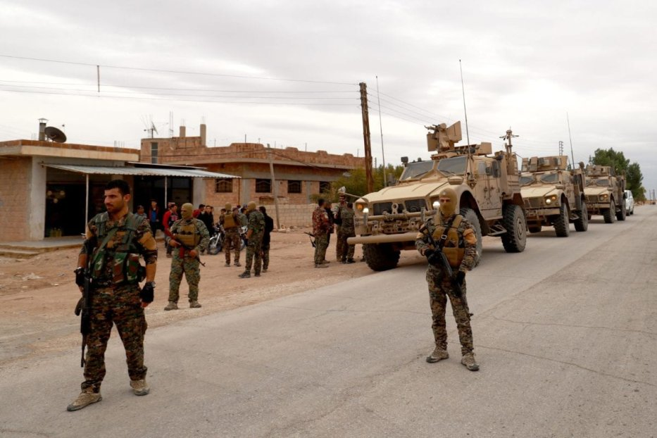 US forces and members of the Syrian Democratic Forces (SDF) patrol the Kurdish-held town of Al-Darbasiyah in northeastern Syria bordering Turkey on November 4, 2018 [DELIL SOULEIMAN/AFP/Getty Images]