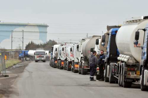Drivers of oil tankers queue to get petrol at the French oil giant Total refinery, on February 22, 2010 in Donges, France [FRANK PERRY/AFP/Getty Images]