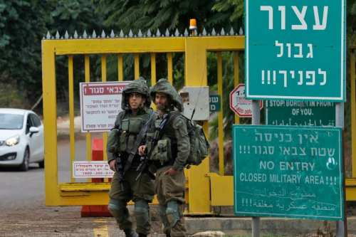 Israeli soldiers stand at a security checkpoint along a road near the northern Israeli town of Metula near the border with Lebanon on December 4, 2018 [JALAA MAREY/AFP/Getty Images]