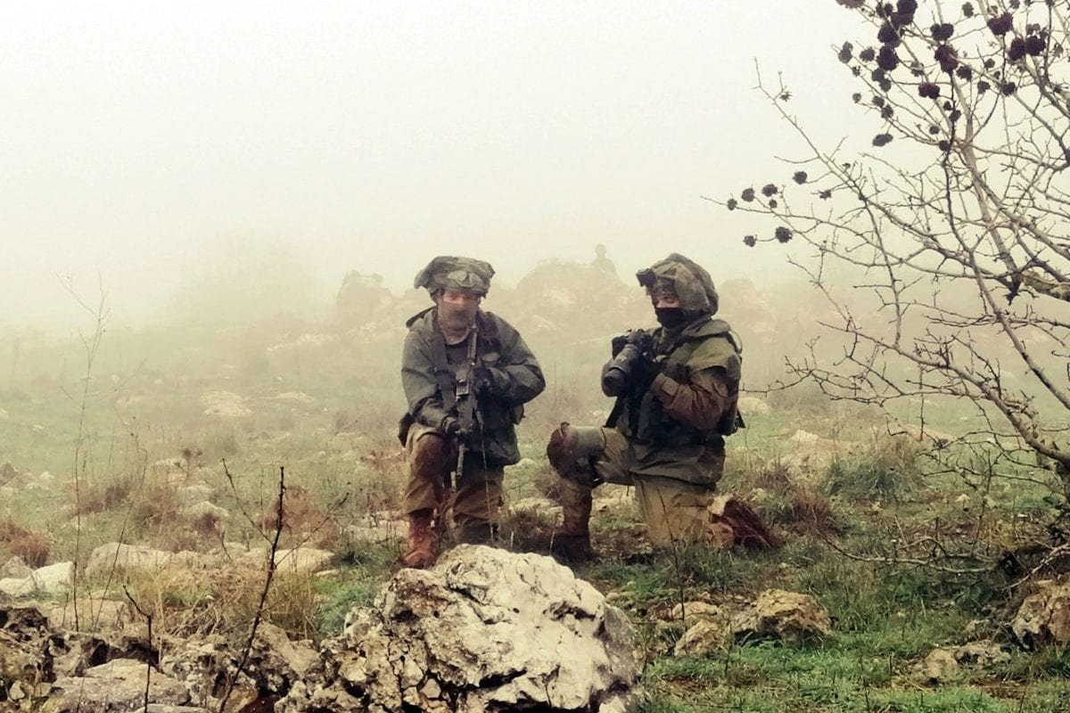 A picture taken from the southern Lebanese village of Meiss al-Jabal on December 9, 2018, shows Israeli soldiers on the Israeli side of the border between the two countries [ALI DIA/AFP/Getty Images]