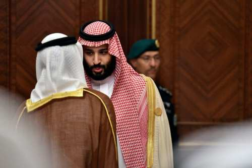 Saudi Crown Prince Mohammed bin Salman is pictured speaking to an unidentified man at the Diriya Palace in the Saudi capital Riyadh during the Gulf Cooperation Council (GCC) summit on December 9, 2018. (Photo by FAYEZ NURELDINE/AFP/Getty Images)