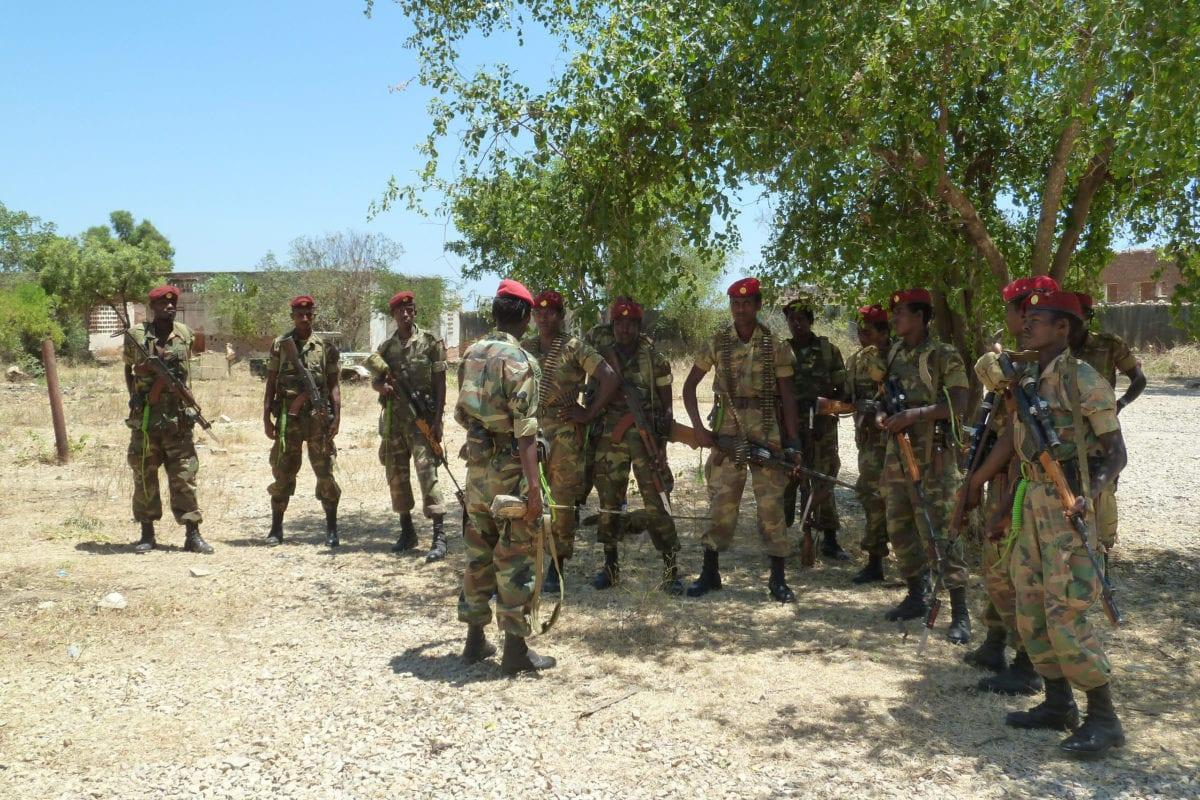 A picture taken on March 2, 2012 shows Ethiopian soldiers receiving a briefing before displaying of weapons left behind by Shebab militias at their former base in Baido, which was taken over from Shebab rebels on February 22,2012 [JENNY VAUGHAN/AFP/Getty Images]