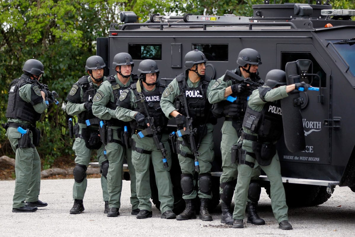 Fort Worth police department S.W.A.T. team members conduct a training exercise on March 21, 2012 in Fort Worth, Texas, United States [Tom Pennington/Getty Images for Texas Motor Speedway]