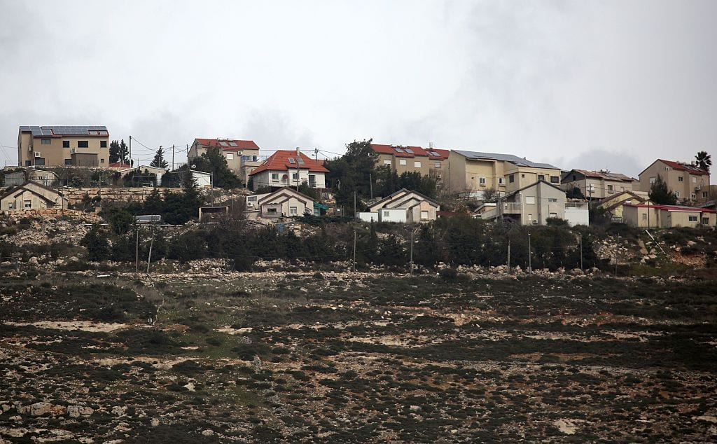 A general view taken on from the Palestinian West Bank village of Burin, showing the Israeli Jewish settlement of Har Brakha [JAAFAR ASHTIYEH/AFP/Getty Images]