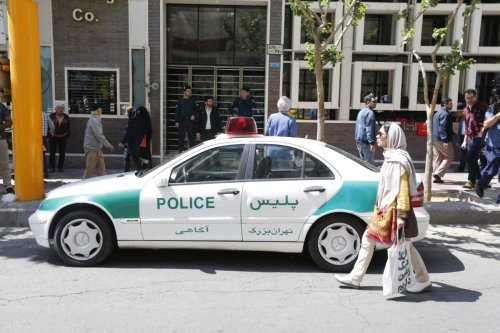 An Iranian police vehicle is seen parked outside a currency exchange shop in the capital Tehran on April 10, 2018 [ATTA KENARE/AFP/Getty Images]