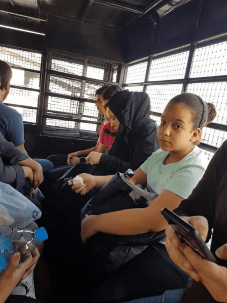 Photos of detained Palestinian refugees being transported in caged police vehicles in Thailand