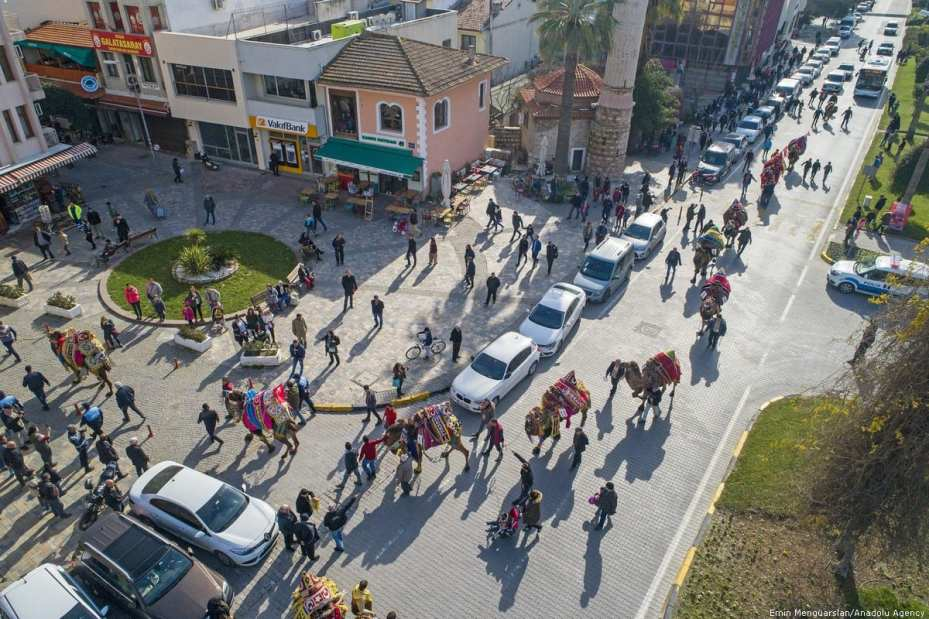 """A drone photo shows camels as they walk during the 8th """"Fanciest Camel"""" competition organized within the 37th Traditional Selcuk Efes Camel Wrestling Festival at Selcuk Station Square in Turkey on 19 January 2019 [Emin Mengüarslan/Anadolu Agency]"""