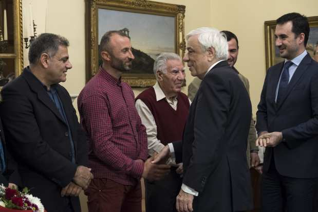 Albanian migrant Jake Gani (2nd L), Egyptian migrants Ibrahim Mahmoud Mousa (not seen) and Al Haimi Emad (not seen) are honoured with Greek citizenship for saving the lives of tens of people in July's fire disaster near the capital Athens, by Greek President Prokopis Pavlopoulos (2nd R) with an official ceremony at the Greek Presidency Building in Athens, Greece on 2 January, 2019 [Ayhan Mehmet/Anadolu Agency]