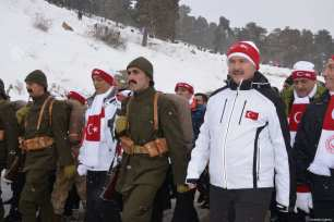 """Turkish Interior Minister Suleyman Soylu (R) attends the """"Turkey Marches with Martyrs"""" event held to commemorate the martyrs of the World War I Battle of Sarikamish, in Kars, Turkey on January 06, 2019 [Hüseyin Demirci / Anadolu Agency]"""