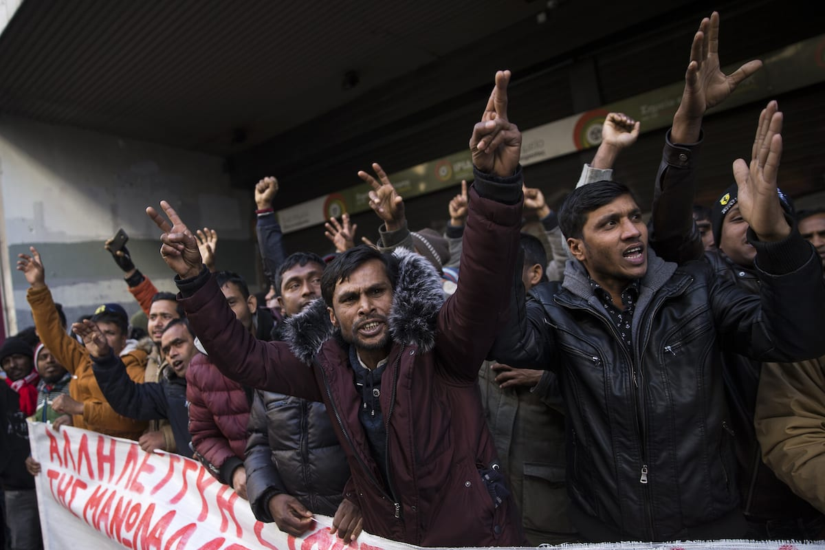 Migrant workers who work at the strawberry fields in Nea Manolada village of Elis district, stage a protest against working conditions in front of the Ministry of Labor in Athens, Greece on 8 January 2019. [Ayhan Mehmet - Anadolu Agency]