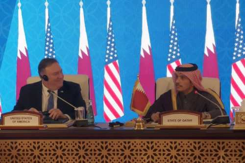 US Secretary of State Mike Pompeo (L) and Qatari Foreign Minister Sheikh Mohammed bin Abdulrahman Al Thani (R) are seen after signing a memorandum of understanding between the two countries, during US-Qatar Strategic Dialogue conference in Doha, Qatar on January 13, 2019 [Serdar Bitmez / Anadolu Agency]