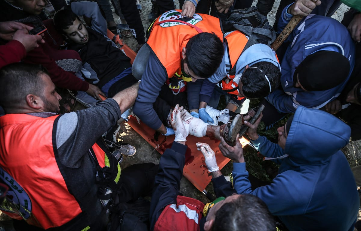 """An injured Palestinian is being carried away after Israeli forces' intervention during a protest within """"Great March of Return"""" demonstrations in Shuja'iyya neighborhood of Gaza City, Gaza on January 18, 2019. ( Ali Jadallah - Anadolu Agency )"""