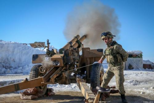 Turkish soldiers fire a cannon at a military base during winter near Turkey-Iraq border in Daglica village of Yuksekova district of Hakkari, Turkey on January 20, 2019 [Özkan Bilgin / Anadolu Agency]