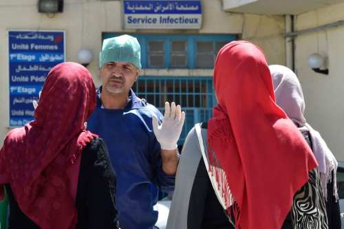 A doctor gestures outside a hospital in the Algerian town of Boufarik, as the country faces a cholera outbreak, on August 28, 2018. [Ryad KRAMDI / AFP / Getty Images]