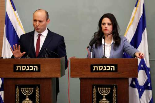 Israeli Education Minister Naftali Bennett (L) speaks as he and Justice Minister Ayelet Shaked (R) give a statement at the Knesset in Jerusalem on November 19, 2018. you may require. (Photo by THOMAS COEX/AFP/Getty Images)