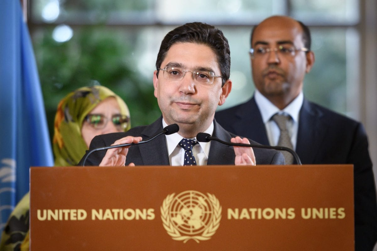 Moroccan Foreign Minister Nasser Bourita (C) attends with his delegation a press briefing closing two days of talks on the Western Sahara region, a disputed region since 2012, on December 6, 2018 at the UN Offices in Geneva. [Fabrice COFFRINI / AFP/ Getty Images]