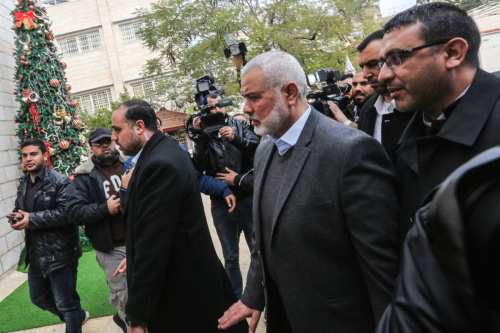 Ismail Haniyeh (C), chairman of Hamas in Gaza City on 29 December 2018 [MAHMUD HAMS/AFP/Getty Images]