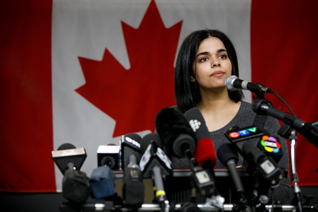 Rahaf Mohammed al-Qunun, 18, addresses the media during a press conference in Toronto at the offices of COSTI, a refugee resettling agency, on 15 January 2019. [COLE BURSTON/AFP/Getty Images]