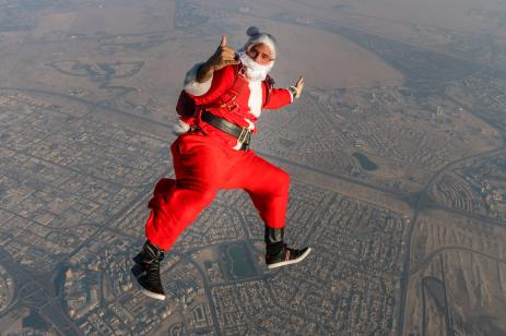 A skydiver dressed as Santa Claus is captured in freefall above Dubai, United Arab Emirates on 20 December 2018 in Dubai, United Arab Emirates [Skydive Dubai via Getty Images]