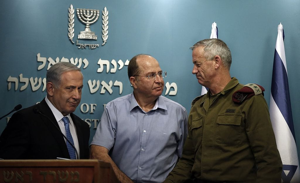 Israeli Prime Minister Benjamin Netanyahu (L) gestures as he stands next to Defence Minister Moshe Yaalon and Chief of Staff General Benny Gantz (R) at the end of a press conference at the prime minister's office in Jerusalem, on 27 August 2014. [THOMAS COEX/AFP/Getty Images]