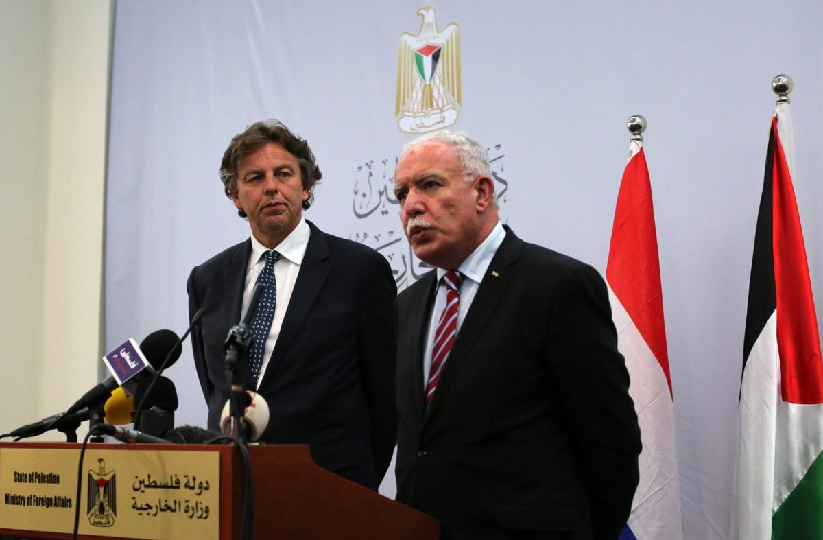 Netherlands' Foreign Minister Bert Koenders (L) listens to his Palestinian counterpart Riyad al-Malki (R) during a press conference at Foreign Affairs ministry in the West Bank city of Ramallah on July 14, 2015. AFP PHOTO / ABBAS MOMANI / Getty Images)